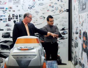 Ford design director of trucks, Pat Schiavone, works with Milton Ruiz