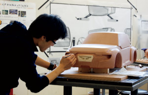 Student Jay Uh works on a clay model