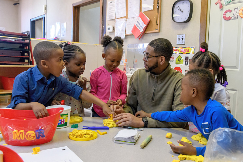 Students and teacher at Brainiacs Clubhouse Child Development Center.