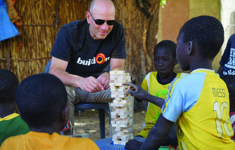 Marc Friedman with children in Senegal