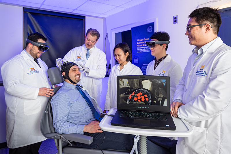 patient wearing technology that allows scientists to see pain