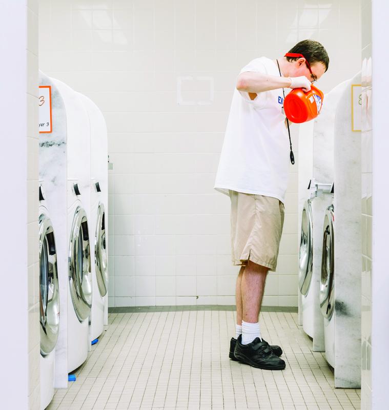 Chris Watttai doing laundry