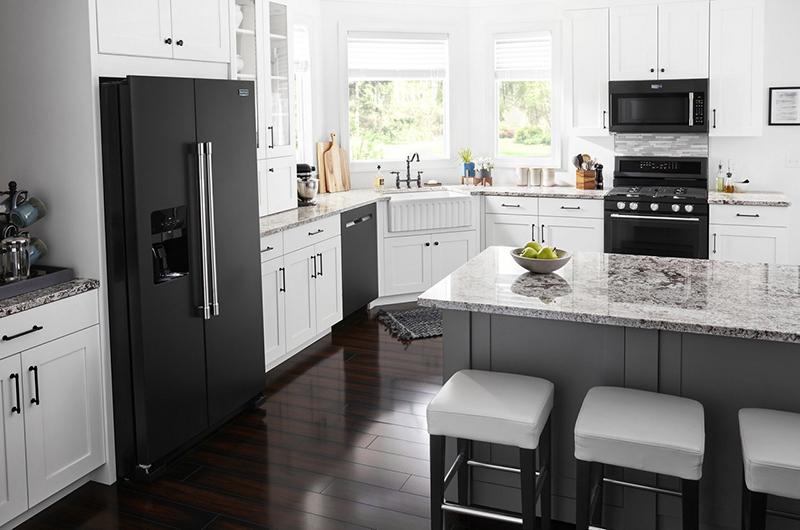 Kitchen with Cast Iron Black Maytag appliances