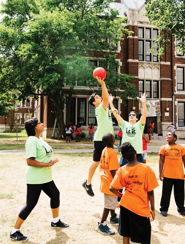 30 in Their Thirties honorees playing basketball with Avengers Youth Mentoring Camp participants