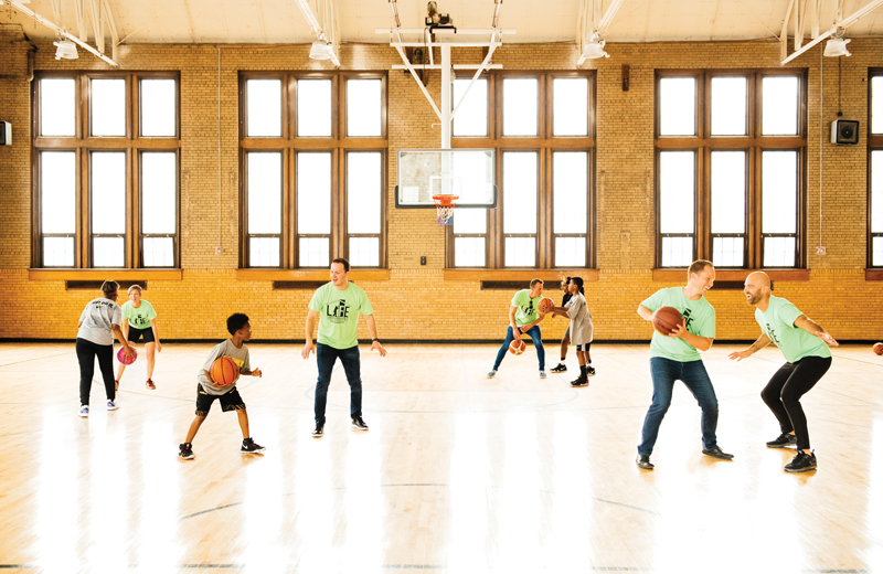 30 in Their Thirties honorees play basketball with The Family's basketball camp participants