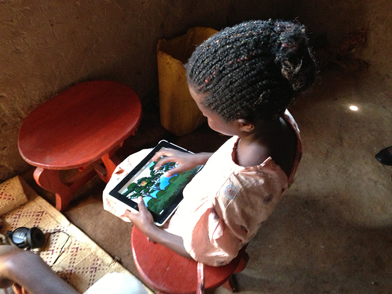 child playing game on tablet