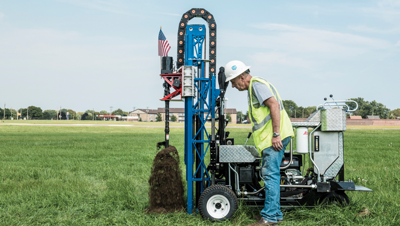 Andrew Niemczyk with portable hydraulic drilling rig MAZL