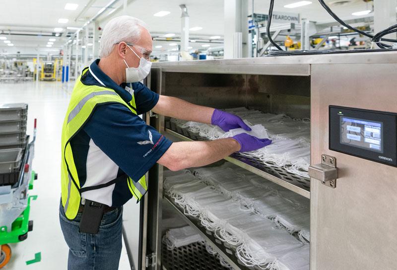 GM worker making face masks