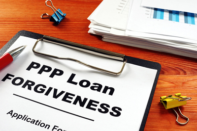 PPP loan forgiveness application stock photo