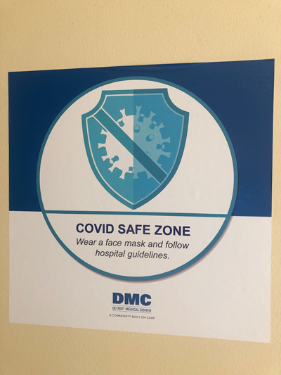 DMC COVID SAFE zone sign