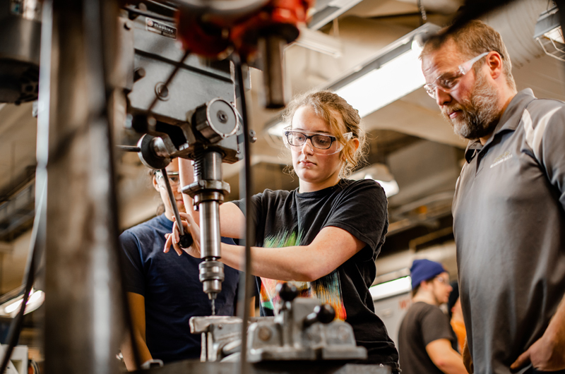 people working in Michigan Technological University's machine shop