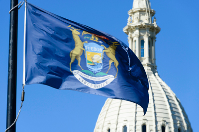 Michigan flag and capitol building