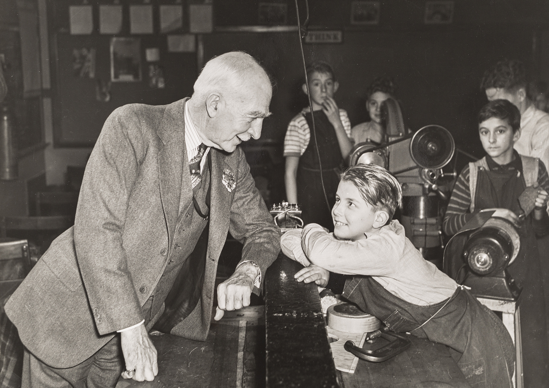 C.S. Mott speaking with child
