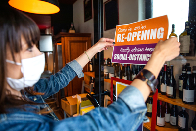 business owner reopening store