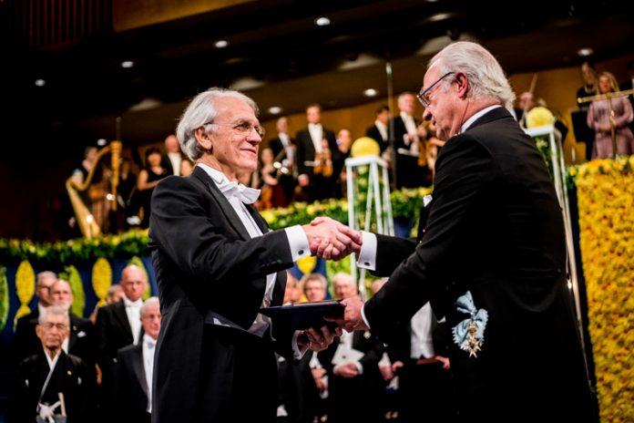 Gérard Mourou receiving Nobel Prize from King of Sweden, Carl XVI Gustaf