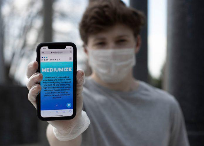 Jonah Liss with Mediumize app on phone