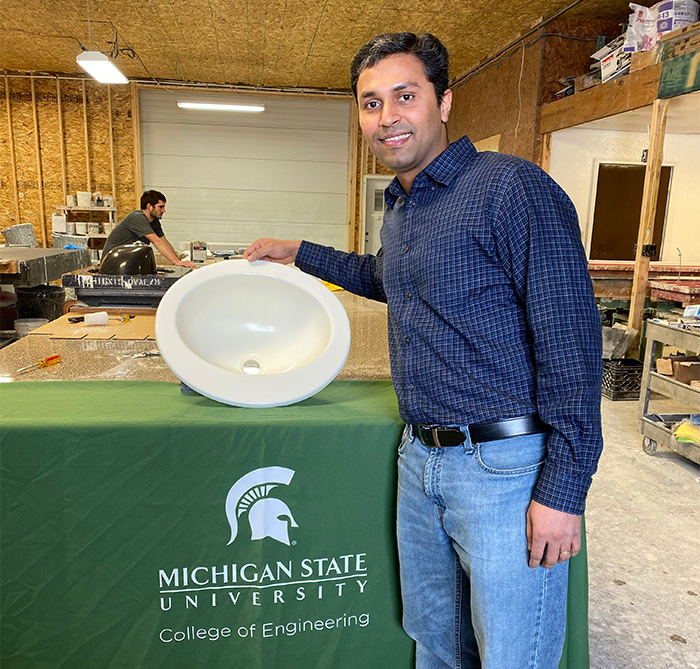 Harshal Bambhania with biorenewable resin sink