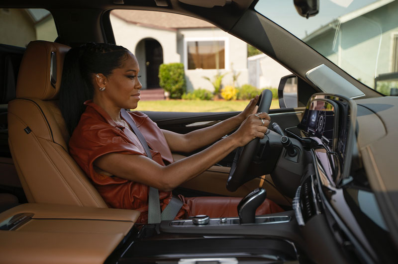 Regina King in Cadillac Escalade