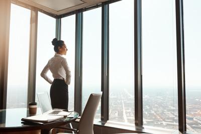 female executive in corner office