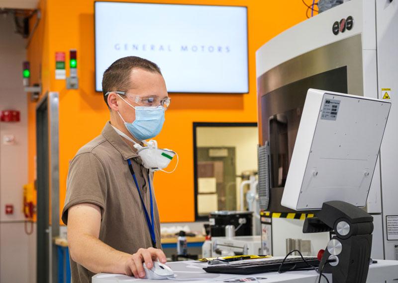 engineer inspecting 3-D printer