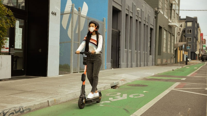 person riding Spin scooter