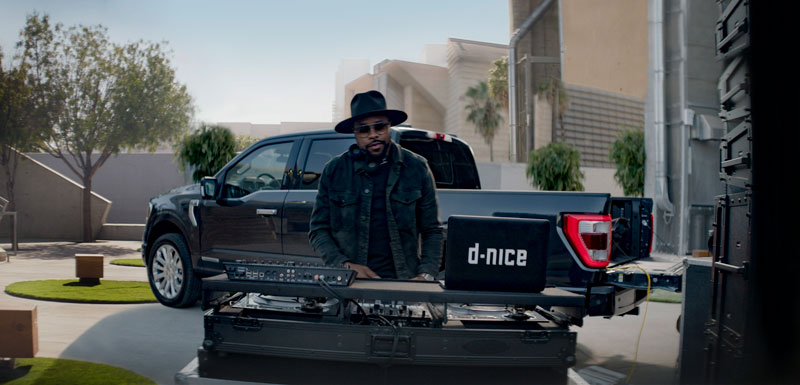 DJ D-Nice in front of a 2021 Ford F-150
