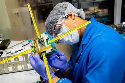 Mayukh Nath of U-M inspects MiTEE-1 satellite