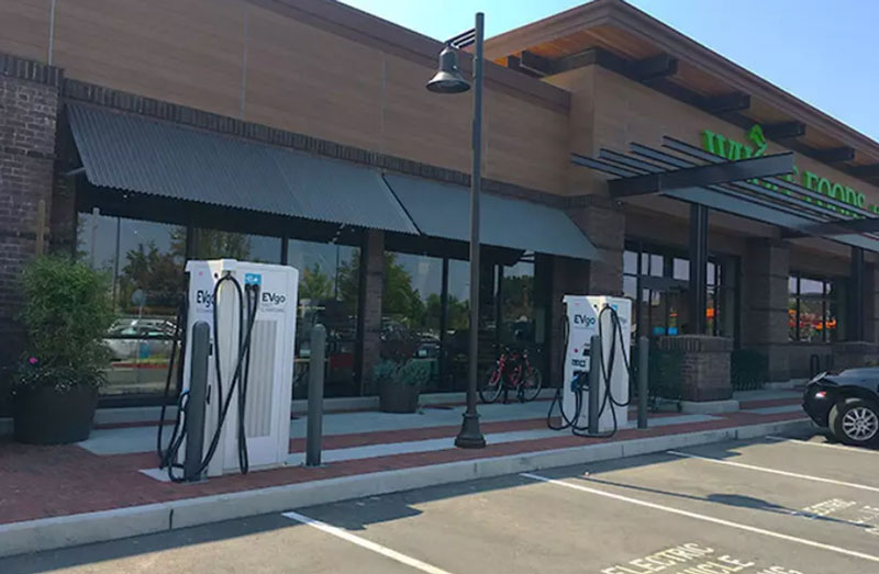 EVgo charging stations in front of a Whole Foods Market location