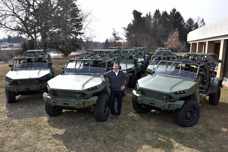 Rick Kewley with GM Defense vehicles