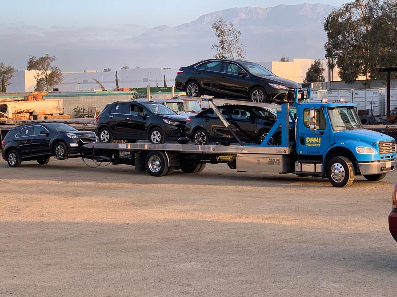 United Road semi truck carrying cars
