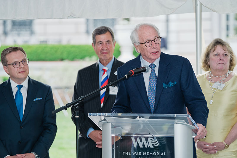 Charles Burke (left), CEO and President of The War Memorial and Donna Hoban, M.D. (right), Board Chair watch Fred M. Alger speak Monday.
