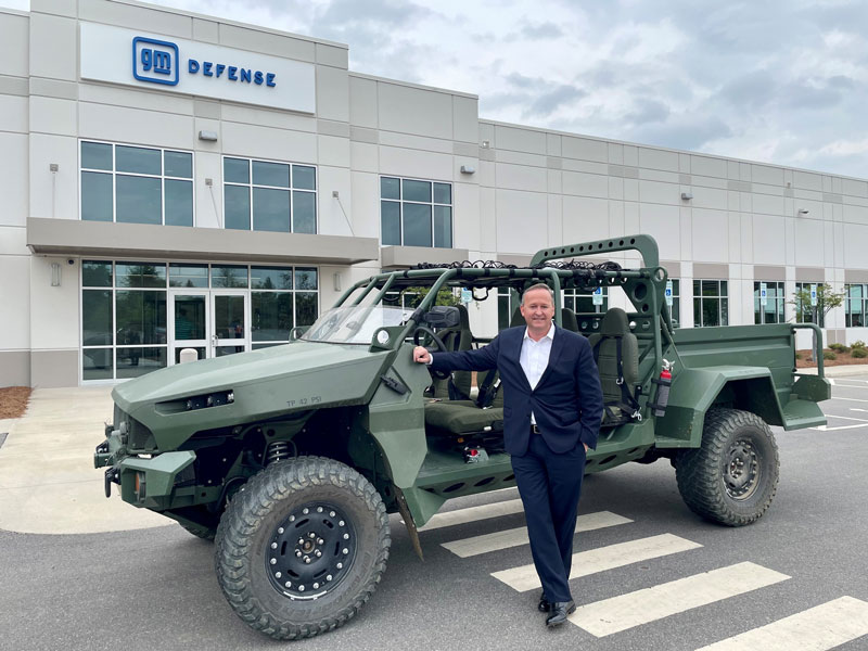Steve duMont with GM Defense vehicle