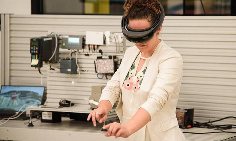 A woman wears a virtual reality headset in the Accenture Detroit Innovation Hub