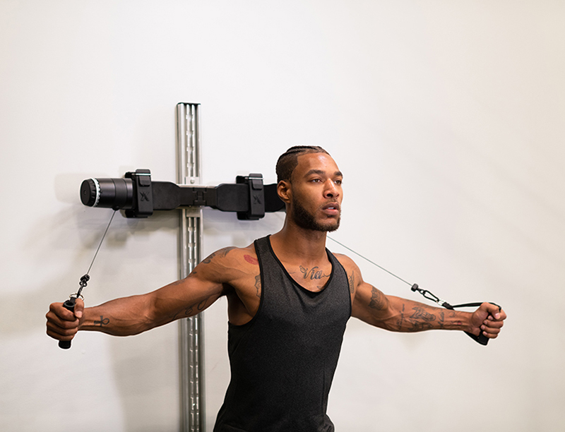 A man uses the MAXPRO system for a chest exercise.