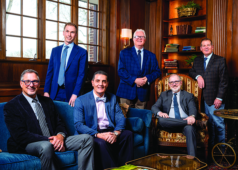 Peninsula capital partners in a wooden meeting room