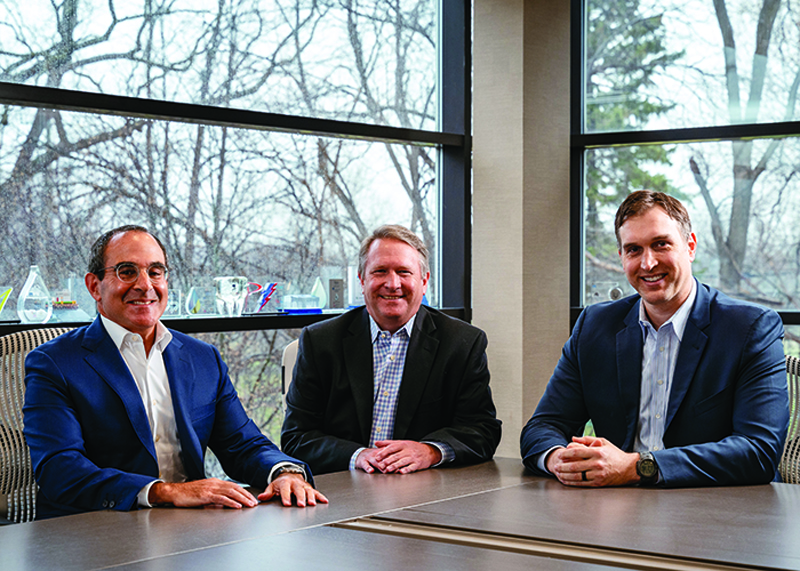 From left to right: Todd Fink, Jay Hansen, and Luke Plumpton sit at a conference table