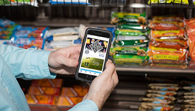 Someone using one of 365 Markets self-serve systems