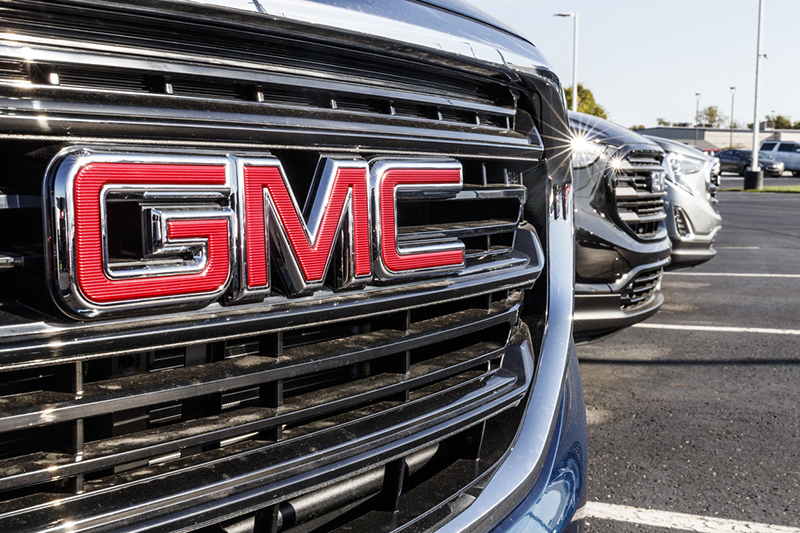 Grills of GMC SUVs in a row