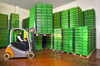 Worker moving product in a cold storage facility.