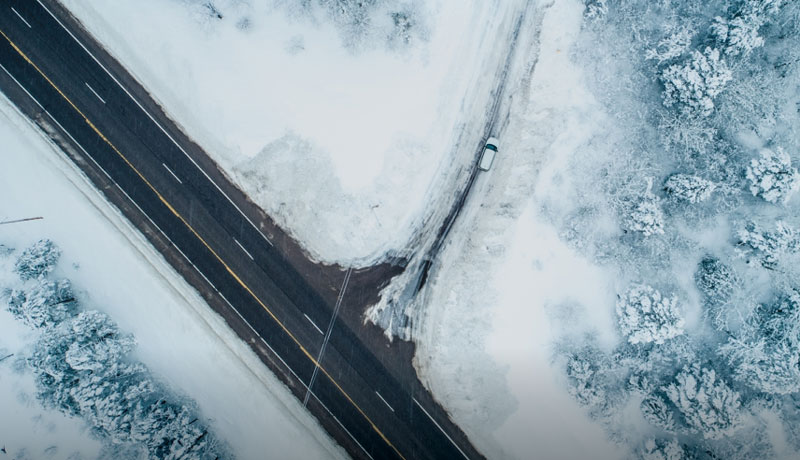 A snowy roadway from above