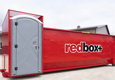 The redbox+ two-in-one dumpster roll-off and portable toilet. The waste management solutions company was acquired by Belfor Franchise Group in Ann Arbor. // Courtesy of redbox+