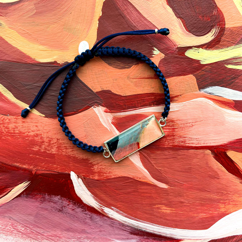 Rebel Nell is collaborating with mural artist Ouizi on a new line of jewelry. // Courtesy of Rebel Nell