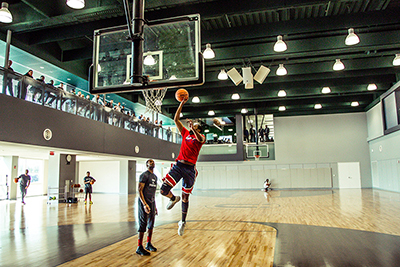 a man shotting a layup on a basketball court