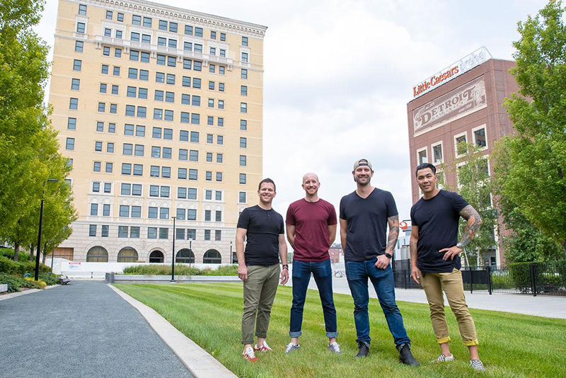 From left to right: John Vermiglio, Chef; Michael Gray, Director of Operations, Will Lee, Beverage Director; Josef Giacomino, Chef, in front of the former Eddystone Hotel, the site of their new dining concept. // Courtesy of Four Man Ladder