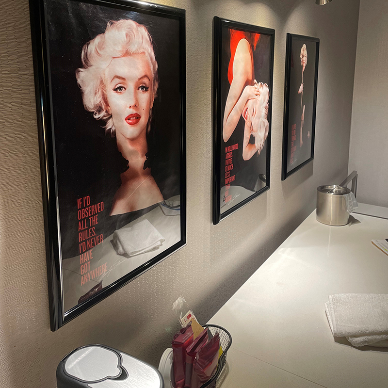 Three framed photos of marilyn monroe in a hotel suite