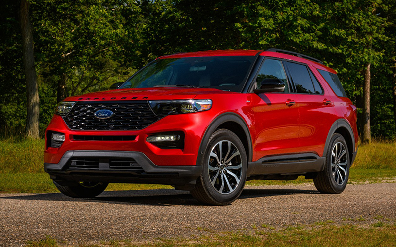 A Red Ford Explorer ST-Line against a forest background