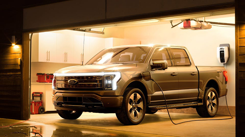 The Ford F-150 Lightning charging in a garage. // Courtesy of Ford