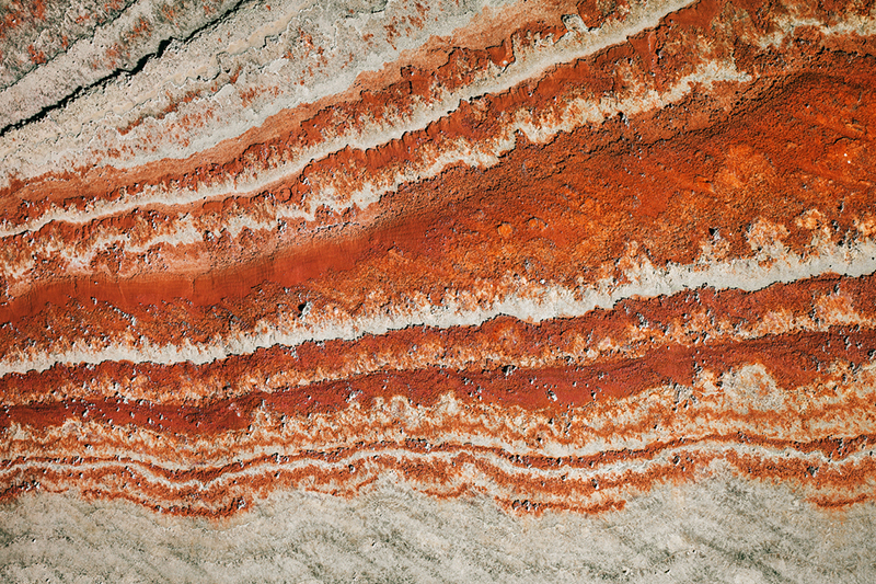 The wall of a potassium mine, the most prevalent mineral in potash, which is crucial to healthy food crops. // Stock Photo