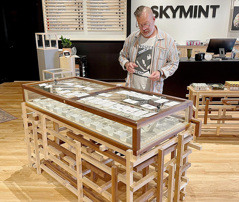 Skymint has opened its 15th Michigan retail store in Coldwater, featuring handmade wooden shelving shown above. // Courtesy of Skymint