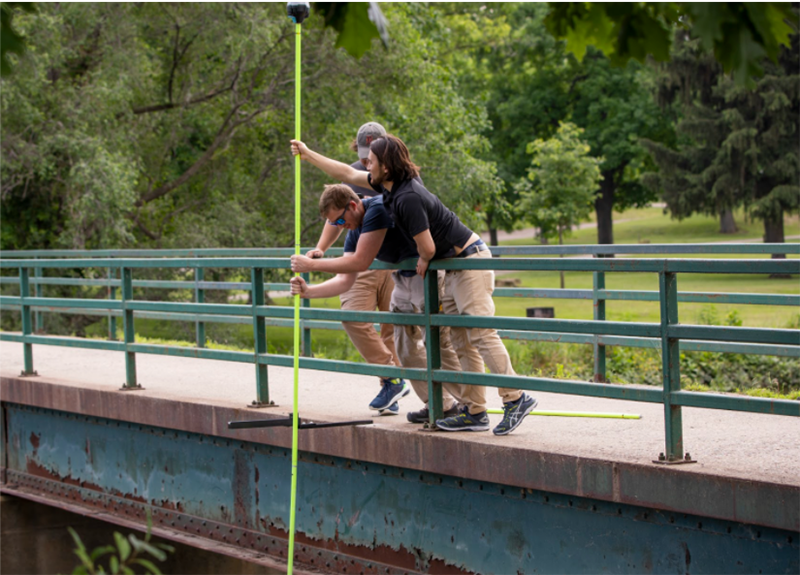 Team members of Hyfi, a water data management service provider that was part of the previous I-Corps program, set up a sensor in the Shiawassee National Wildlife Refuge in Saginaw. // Courtesy of U-M